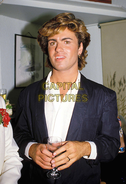 GEORGE MICHAEL - WHAM.Ref: 026.drink, glass of wine, half length, half-length.www.capitalpictures.com.sales@capitalpictures.com.© Capital Pictures