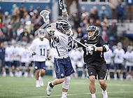 Washington, DC - April 7, 2018: Georgetown Hoyas Massimo Bucci (37) gets pushed by Providence Friars David Procopio (14) during game between Providence and Georgetown at  Cooper Field in Washington, DC.   (Photo by Elliott Brown/Media Images International)