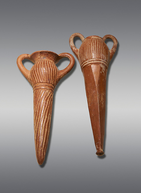 Bronze Age Anatolian terra cotta two handled beakers - 19th to 17th century BC - Kültepe Kanesh - Museum of Anatolian Civilisations, Ankara, Turkey. Against a grey background.