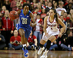 VERMILLION, SD, APRIL 2:  DyTiesha Dunson #0 from Florida Gulf Coast pushes the ball up court past Tia Hemiller #4 from the University of South Dakota during the WNIT Championship game Saturday afternoon at the Dakota Dome in Vermillion, S.D. (Photo by Dave Eggen/Inertia)