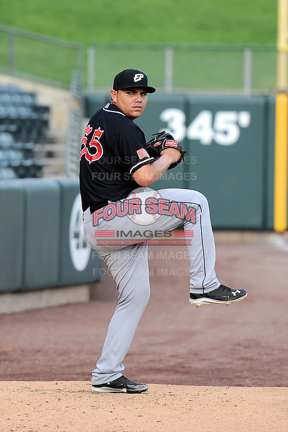 Juan Pablo Oramas (55) of the El Paso Chihuahuas warms up before the game against the Salt Lake Bees in Pacific Coast League action at Smith's Ballpark on August 7, 2014 in Salt Lake City, Utah.  (Stephen Smith/Four Seam Images)