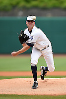 NW Arkansas Naturals pitcher Sam Selman (17) delivers a warmup pitch during a game against the Corpus Christi Hooks on May 26, 2014 at Arvest Ballpark in Springdale, Arkansas.  NW Arkansas defeated Corpus Christi 5-3.  (Mike Janes/Four Seam Images)