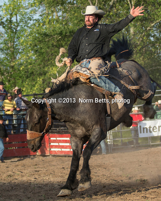 Action at the Ultimate Rodeo Tour stop in Shannonville, Ontario, Canada, 21 June, 2013<br /> Photo by Norm Betts <br /> tel:416 460 8743<br /> &copy;2013 Norm Betts, photog