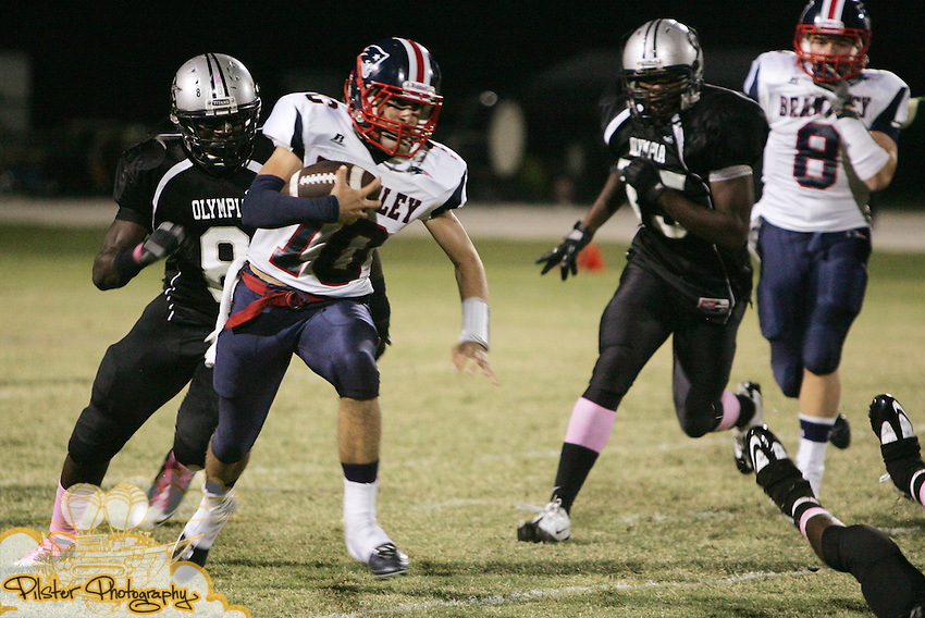 Lake Brantley's Damon Haecker (10), the quarterback, runs the ball on Friday, October 14, 2011 at Olympia High School in Orlando, Florida. Olympia played Lake Brantley in high school football.   (Special to the Orlando Sentinel by Chad Pilster of http://www.PilsterPhotography.net)