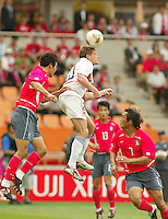 Brian McBride goes up for a header. The USA tied South Korea, 1-1, during the FIFA World Cup 2002 in Daegu, Korea.
