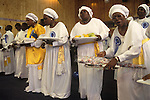 The Celestial Church of Christ east London. This church congregation is mainly made up of Yoruba people from western Nigeria. Female members of the church bring offerings  to the alter at the opening of a new church in East London. from A STORM IS PASSING OVER a Look at Black Churches in Britain. Published by Thames and Hudson isbn 0 500 27826 1