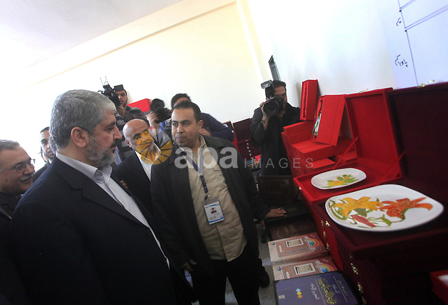 """Hamas chief Khaled Meshaal, is greeted during his visit to a project funded by the Turkish President ragab ardogan in the Islamic University in Gaza City December 9, 2012. Meshaal, in a defiant speech during his first ever visit to Gaza, told a mass rally on Saturday he would never recognise Israel and pledged to """"free the land of Palestine inch by inch"""". Photo by Ashraf Amra"""