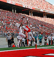 Ohio State Buckeyes cornerback Gareon Conley (8) knocks the ball away from Northern Illinois Huskies wide receiver Kenny Golladay (19) in the 4th quarter of their game at Ohio Stadium on September 19, 2015.  (Dispatch photo by Kyle Robertson)