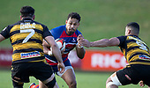 Sailosi Vatubua makes a run at Mitchell Thackham and Tofaga Iese. Counties Manukau Premier 1 McNamara Cup Final between Ardmore Marist and Bombay, played at Navigation Homes Stadium on Saturday July 20th 2019.<br />  Bombay won the McNamara Cup for the 5th time in 6 years, 33 - 18 after leading 14 - 10 at halftime.<br /> Photo by Richard Spranger.