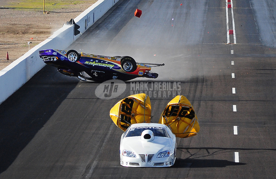 Feb. 20, 2010; Chandler, AZ, USA; NHRA pro stock driver Vinnie Deceglie crashes alongside Bob Yonke during qualifying for the Arizona Nationals at Firebird International Raceway. Mandatory Credit: Mark J. Rebilas-