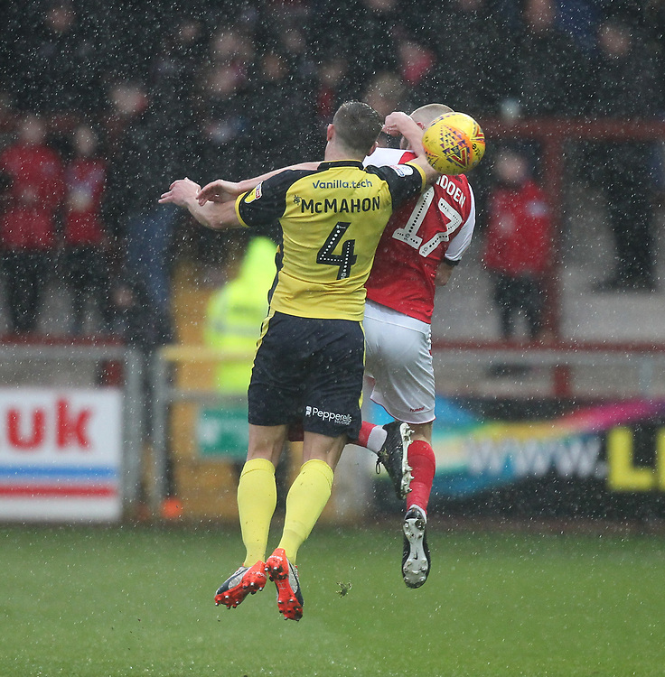 Fleetwood Town's Paddy Madden  jumps with  Scunthorpe Utd's Anthony McMahon<br /> <br /> Photographer Mick Walker/CameraSport<br /> <br /> The EFL Sky Bet League One - Fleetwood Town v Scunthorpe United - Saturday 26th January 2019 - Highbury Stadium - Fleetwood<br /> <br /> World Copyright © 2019 CameraSport. All rights reserved. 43 Linden Ave. Countesthorpe. Leicester. England. LE8 5PG - Tel: +44 (0) 116 277 4147 - admin@camerasport.com - www.camerasport.com