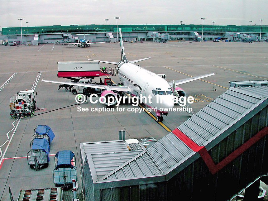 Go aircraft being refuelled and reprovisioned on the tarmac at London Stanstead Airport. Ref: 200202123290.<br />