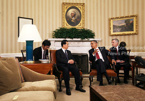 United States President Barack Obama (2R) and President Hu Jintao of China (2L) meet in the Oval Office with interpreters at the White House, Wednesday, January 19, 2011 in Washington, DC. Obama and Hu are scheduled to hold a joint press conference and attend a State dinner. .Credit: Alex Wong / Pool via CNP