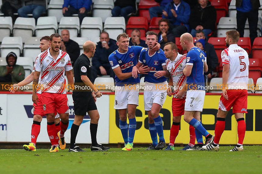 Stevenage players complain to referee Nicholas Kinseley after a penalty is awarded against Luke Wilkinson during Stevenage vs Carlisle United, Sky Bet EFL League 2 Football at the Lamex Stadium on 22nd October 2016