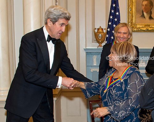 United States Secretary of State John Kerry shakes hands with blues singer Mavis Staples, one of the five recipients of the 39th Annual Kennedy Center Honors, after they posed for a group photo following a dinner hosted by United States Secretary of State John F. Kerry in their honor at the U.S. Department of State in Washington, D.C. on Saturday, December 3, 2016.  The 2016 honorees are: Argentine pianist Martha Argerich; rock band the Eagles; screen and stage actor Al Pacino; gospel and blues singer Mavis Staples; and musician James Taylor.<br /> Credit: Ron Sachs / Pool via CNP