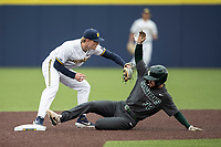 Michigan Wolverines shortstop Jack Blomgren (2) records a force out at second base as Michigan State baserunner Zach Iverson (32) slides into the base during the NCAA baseball game on May 7, 2019 at Ray Fisher Stadium in Ann Arbor, Michigan. Michigan defeated Michigan State 7-0. (Andrew Woolley/Four Seam Images)