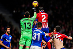 Diego Roberto Godin Leal of Atletico de Madrid (R) competes for the ball with goalkeeper Iago Herrerin of Athletic de Bilbao (L) during the La Liga 2018-19 match between Atletico de Madrid and Athletic de Bilbao at Wanda Metropolitano, on November 10 2018 in Madrid, Spain. Photo by Diego Gouto / Power Sport Images