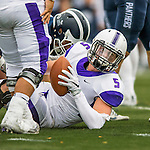 8 October 2016: Amherst College Purple & White Wide Running Back Nick Kelly, a Senior from Westport, CT, is tackled during play against the Middlebury College Panthers at Alumni Stadium in Middlebury, Vermont. The Panthers edged out the Purple & While 27-26. Mandatory Credit: Ed Wolfstein Photo *** RAW (NEF) Image File Available ***