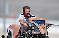 Mar. 31, 2012; Las Vegas, NV, USA: NHRA top fuel Harley motorcycle rider Devin XXXX during qualifying for the Summitracing.com Nationals at The Strip in Las Vegas. Mandatory Credit: Mark J. Rebilas-