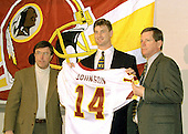 Newly acquired Washington Redskins quarterback Brad Johnson (14) appears at Redskins Park in Ashburn, Virginia for a press conference following his trade from the Minnesota Vikinga for a 1st & 3rd round draft choice in 1999 and a 2nd round draft choice in 2000 on February 16, 1999. From left to right: Redskins general manager Charlie Casserly, Johnson, and head coach Norv Turner.<br /> Credit: Arnie Sachs / CNP