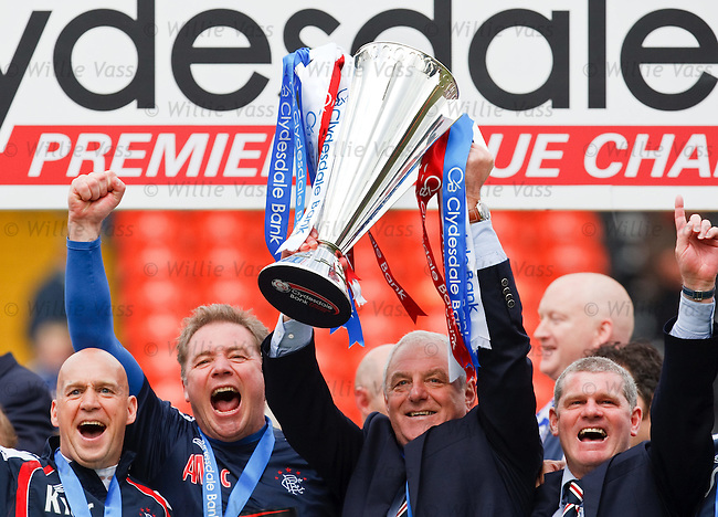 Rangers management team lift the SPL trophy. Kenny McDowall, Ally McCoist, Walter Smith and Ian Durrant