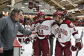 John O'Donnell (Harvard - Equipment Manager), Dan Ford (Harvard - 5), Max Everson (Harvard - 44), Patrick McNally (Harvard - 8) - The visiting Boston College Eagles defeated the Harvard University Crimson 5-1 on Wednesday, November 20, 2013, at Bright-Landry Hockey Center in Cambridge, Massachusetts.