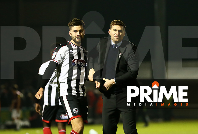 Harry Cardwell of Grimsby Town and Grimsby Town Manager Michael Jolley after during the Sky Bet League 2 match between Northampton Town and Grimsby Town at Sixfields Stadium, Northampton, England on 24 November 2018. Photo by Leila Coker / PRiME Media Images.