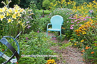 63821-205.13  Garden path with armillary, blue chair and birdhouses.  Yellow Daylillies (Hemerocallis)  Black-eyed Susans (Rudbeckia hirta), Purple Coneflowers (Echinacea purpurea), Gray-headed Coneflowers (Ratibida pinnata) and Pink Bee balm (Monarda fistulosa), Butterfly Milkweed (Asclepias tuberosa)  Marion Co. IL