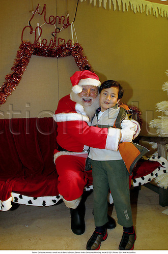 Father Christmas meets a small boy in Santa's Grotto, Cantor Index Christmas Meeting, Ascot 021221. Photo: Glyn Kirk/Action Plus...2002.horse racing.santa national hunt
