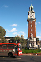 The Big Ben like clock tower called Torre de los Ingleses (the Englishmen's tower) renamed Torre Monumental (Monumental Tower) on the Plaza San Martin Square renamed Plaza de la Fuerza Aerea or Plaza Fuerza Retiro. Retiro railway station in the background. Red city bus in the foreground. Buenos Aires Argentina, South America