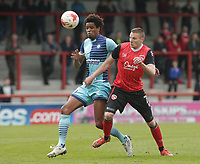 Sido Jombati (L) of Wycombe Wanderers challenges for the ball with Paul Mullin (R) of Morecambe during the Sky Bet League 2 match between Morecambe and Wycombe Wanderers at the Globe Arena, Morecambe, England on 29 April 2017. Photo by Stephen Gaunt / PRiME Media Images.
