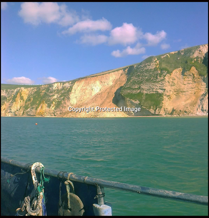 BNPS.co.uk (01202 558833).Pix: JoeMiller/BNPS..***Please Use Full Byline***..The view of the massive landfall from fisherman Joe Miller's boat. ..A massive cliff has struck the Dorset Jurassic coast today near Durdle Door. Tens of thousands of tones of rock has come crashing down onto a remote beach in St Oswalds Bay. The MCA helicopter spotted the fall.