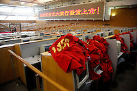 Unused computer trading terminals and stock trader vests lay on the trading desk of the Shanghai Stock Exchange (SSE) in Shanghai, China. The Shanghai Stock Exchange is one of the three stock exchanges operating independently in the People's Republic of China, the other two are the Shenzhen Stock Exchange and the Hong Kong Stock Exchange. It is the world's sixth largest stock market by market capitalization at US$2.4 trillion as of Aug 2010..18 Aug 2010