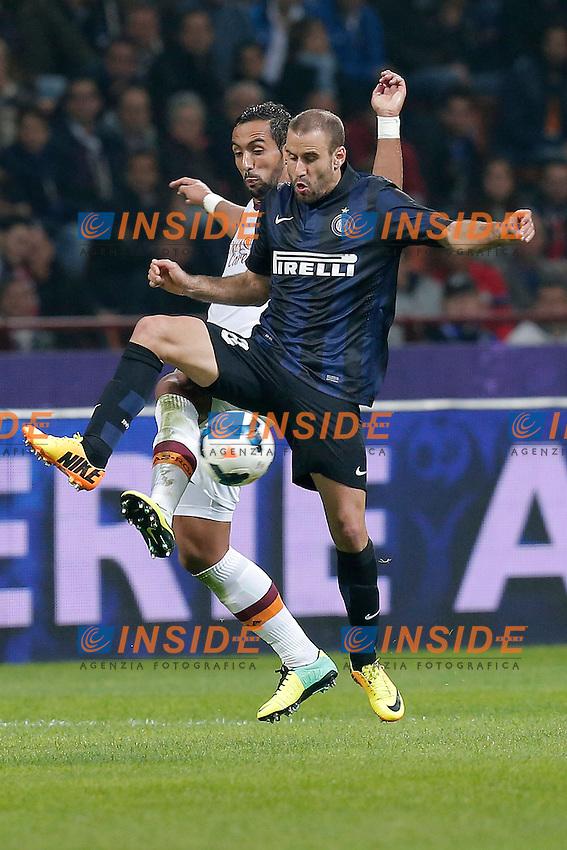 Mehdi Benatia Roma, Rodrigo Palacio Inter, <br /> Milano 05-10-2013<br /> Stadio Giuseppe Meazza <br /> Football Calcio 2013/2014 Serie A <br /> Inter - Roma<br /> Foto Marco Bertorello Insidefoto
