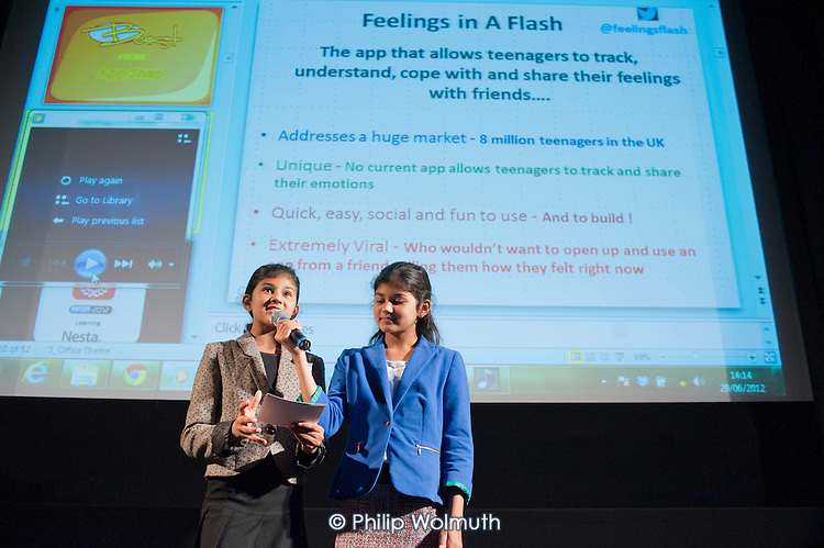 Two 12-year-old members of Blackheath Computer Club promote the Feelings in a Flash smartphone app at the Apps for Good Awards 2012, the Barbican, London.