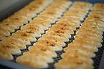 Freshly made Sasa-kamaboko line the shelves at Oizen Shoten's factory in Tome City, Miyagi Prefecture, Japan on 11 Sept. 2012.  Photographer: Robert Gilhooly