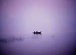 Single fishing boat in calm water