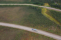 Aerial of semi tractor trailer hauling supplies on the James Dalton Highway, arctic, Alaska.