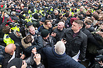 "© Joel Goodman - 07973 332324. 18/03/2018 . London , UK . TOMMY ROBINSON (right) and supporters are separated from those opposed to his speech by a line of police as Robinson delivers his speech to the crowd . 1000s including supporters of alt-right groups such as Generation Identity and the Football Lads Alliance , at Speakers' Corner in Hyde Park where Tommy Robinson reads a speech by Generation Identity campaigner Martin Sellner . Along with Brittany Pettibone , Sellner was due to deliver the speech last week but the pair were arrested and detained by police when they arrived in the UK , forcing them to cancel an appearance at a UKIP "" Young Independence "" youth event , which in turn was reportedly cancelled amid security concerns . Photo credit : Joel Goodman"