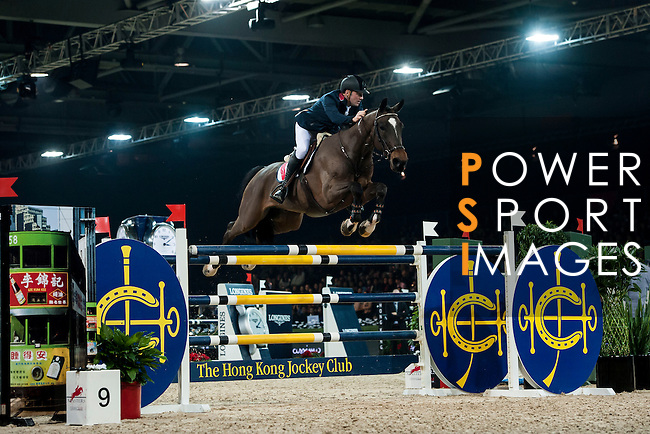 Philipp Weishaupt of Germany rides Carinou at the Longines Grand Prix during the Longines Hong Kong Masters 2015 at the AsiaWorld Expo on 15 February 2015 in Hong Kong, China. Photo by Xaume Olleros / Power Sport Images