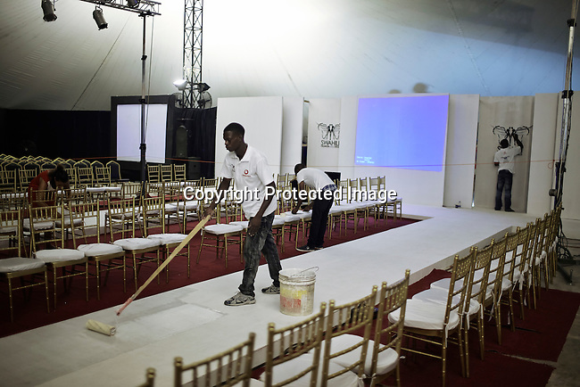 DAR ES SALAAM, TANZANIA - DECEMBER 7: A crew paints the runway before fashion shows at Swahili Fashion week on December 7, 2013 in Dar Es Salaam, Tanzania. The yearly fashion week show local Swahili designers work and invited African designers. (Photo by: Per-Anders Pettersson)