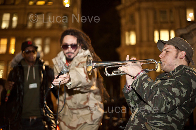 """Onlyjoe, music band - 2011<br /> <br /> London, 23/11/2011. The 18th of November 2011 the Occupy London movement made its third occupation. A disused UBS office building, near Finsbury Square (the second camp), became the """"Bank Of Ideas"""". Today the new occupied space hosted an anti-war art exhibition and a political song writing workshop led by the musician and activist Billy Bragg. At around 19:00, at the St Paul's camp, the Onlyjoe (music band) performed outside the Cathedral."""