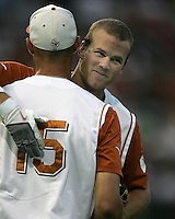 Texas RF Kyle Russell hugs teammate Jordan Danks (15) against Texas A&M on May 16th, 2008 in Austin Texas. Photo by Andrew Woolley / Four Seam Images.