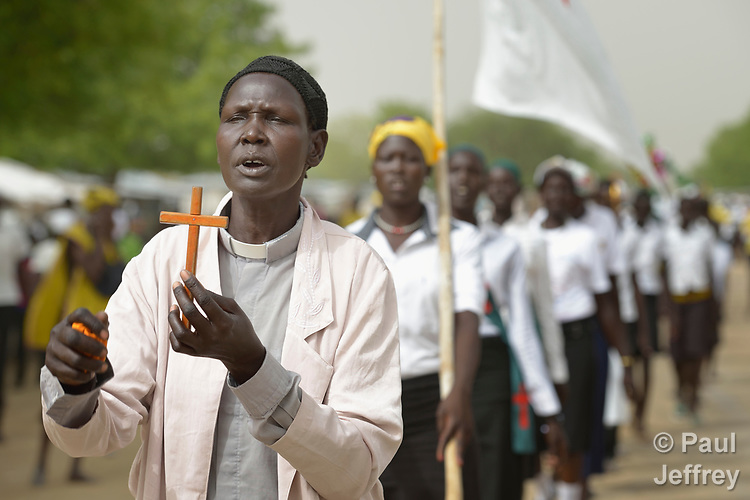 Christians march in a public procession on Easter Sunday, April 16, 2017, in Pawel, a village in South Sudan's Jonglei State.<br /> <br /> South Sudan's churches have played a critical role in trying to mediate the conflict which has torn apart the world's newest nation since 2013, and members of the ACT Alliance collaborate closely with them to support peace and reconciliation.