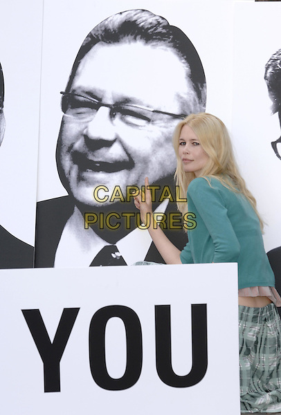 "RALPH GOODALE (CANADA) & CLAUDIA SCHIFFER .Poses at a photocall for the Global Call To Action Against Poverty (GCAP), in front of images of the G8 Finance Ministers to say ""we'll be watching you"",.Westminster, London, June 9th 2005..half length green cardigan striped top white rubber bracelet pointing finger gesture.Ref: PL.www.capitalpictures.com.sales@capitalpictures.com.©Capital Pictures"