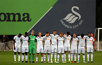 Pictured: Swansea players observe a minute's silence in tribute to honorary president Gwilym Joseph. Friday 11 August 2017<br /> Re: Premier League 2, Division 1, Swansea City U23 v Liverpool U23 at the Landore Training Ground, Swansea, UK