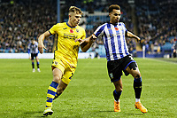 Jake Bidwell of Swansea City (L) in action during the Sky Bet Championship match between Sheffield Wednesday and Swansea City at Hillsborough Stadium, Sheffield, England, UK. Saturday 09 November 2019
