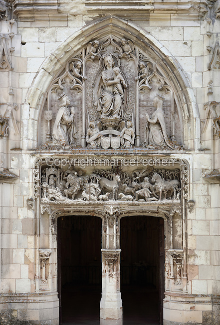 Entrance to the Chapelle Saint-Hubert, built 1491-96 in Flamboyant Gothic style, at the  Chateau d'Amboise, a medieval castle of the Loire Valley which became a royal residence in the 15th century and was largely reworked in the 15th and 16th centuries, at Amboise, Indre-et-Loire, Centre, France. The chapel was carved under Charles VIII in Italianate style by Flemish craftsmen in stone and tufa. The lintel represents St Hubert hunting and the 19th century tympanum, Charles VIII and Anne of Brittany kneeling before the Virgin. The chapel also served as an oratory for Anne of Brittany and presumed final resting place of Leonardo da Vinci, who died at Amboise in 1519. The chateau is listed as a historic monument. Picture by Manuel Cohen