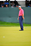 29 August 2009: Paul Goydos putts on the 18th green during the third round of The Barclays PGA Playoffs at Liberty National Golf Course in Jersey City, New Jersey.