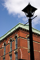 Old fashioned street light and Victorian building in the city of Saint John, New Brunswick, Canada